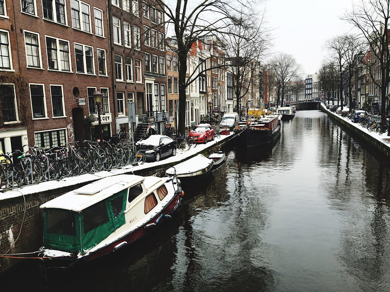 Canal Mode Of Transport Nautical Vessel Architecture Building Exterior Reflection City Transportation Built Structure Water Outdoors Bare Tree Tree Waterfront No People Cultures Day Nature Winter
