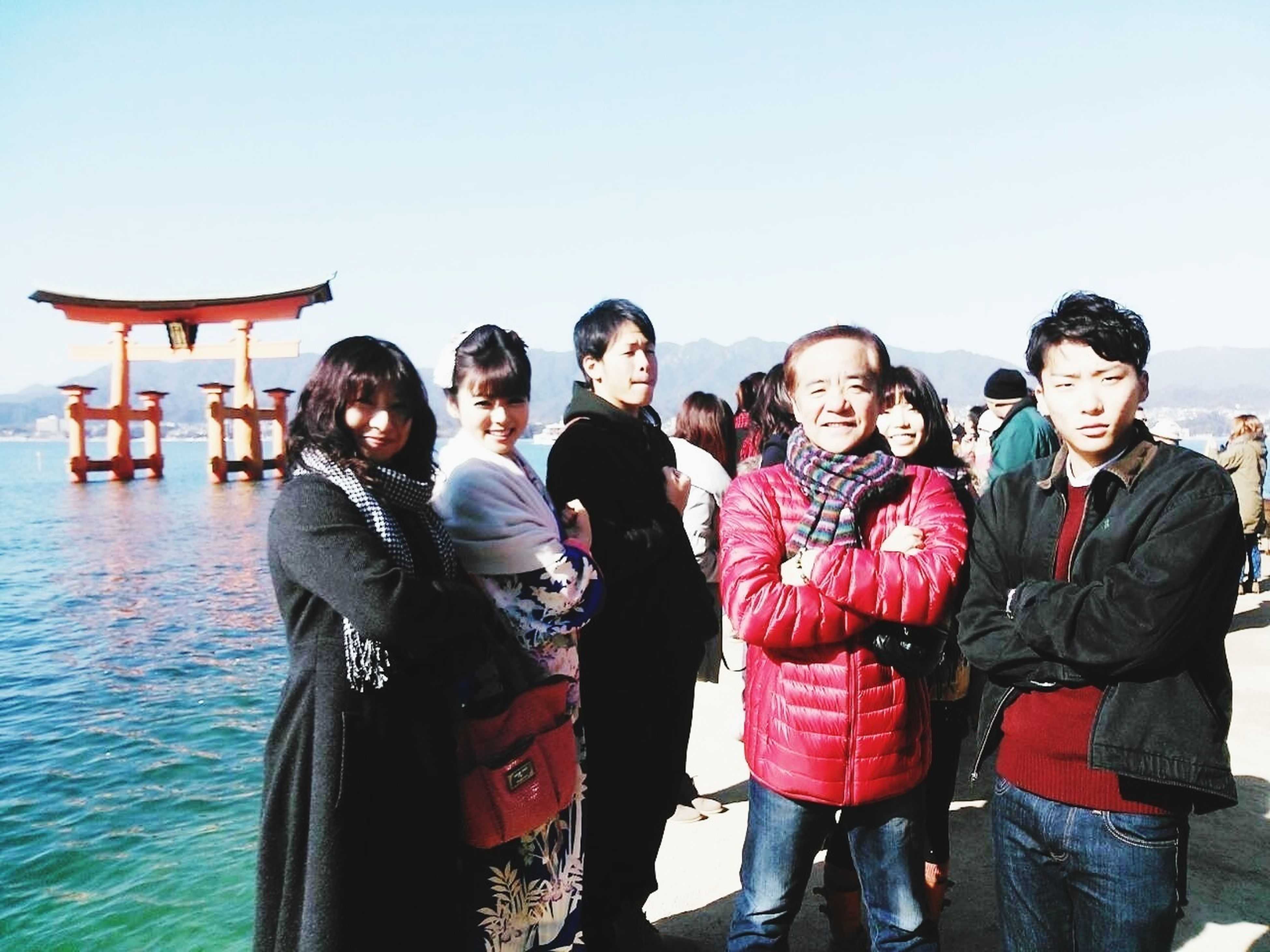 togetherness, lifestyles, bonding, leisure activity, water, love, friendship, men, clear sky, standing, casual clothing, family, young men, sea, enjoyment, vacations, copy space, fun