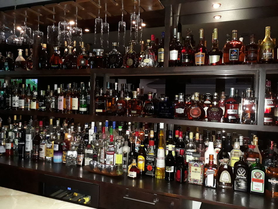 Large Group Of Objects Wine Bottle Alcohol Choice Abundance In A Row Variation Wine Bottle Liquor Store Indoors  Shelf Food And Drink Drink No People Wine Rack Day