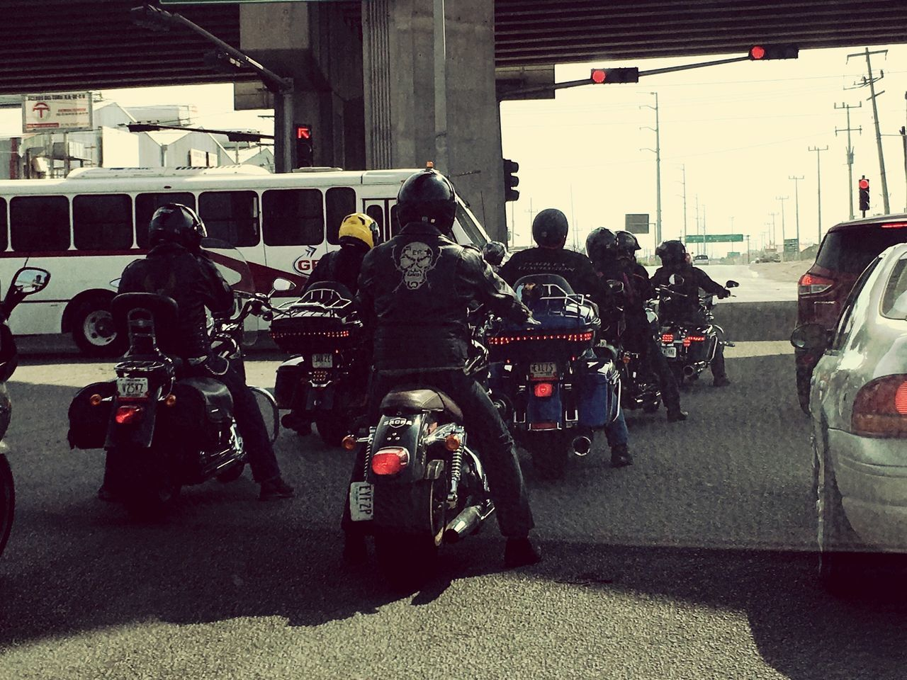 transportation, land vehicle, real people, men, mode of transport, motorcycle, stationary, women, day, uniform, helmet, built structure, large group of people, full length, lifestyles, standing, architecture, building exterior, outdoors, biker, adult, people
