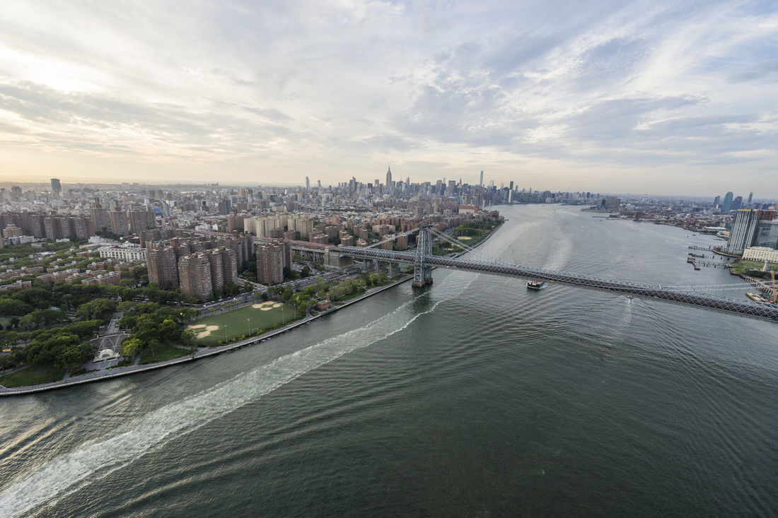 New York City Sunset by Helicopter Above Aerial Photography Aerial View Architecture Bridge Built Structure City Cityscape Cityscapes Helicopter New York No People Outdoors River Sky Sunset Travel Destinations Urban Water