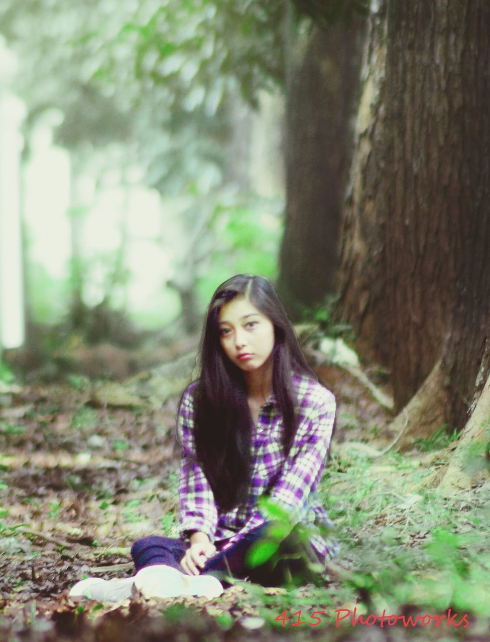one person, tree, long hair, forest, black hair, real people, casual clothing, tree trunk, nature, day, sitting, beautiful woman, young adult, outdoors, young women, people