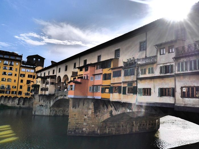 Ponte Vecchio bathed in sunshine Architecture Water Building Exterior Sunlight Waterfront Built Structure River Day Sky No People Outdoors Nature Ponte Vecchio The Architect - 2017 EyeEm Awards Sunshine
