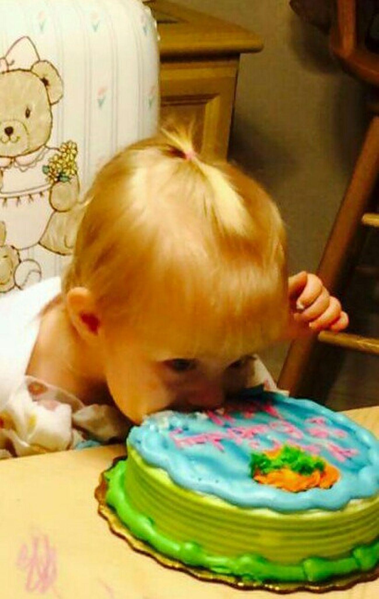 She really loves her birthday cake! Happy First Birthday!