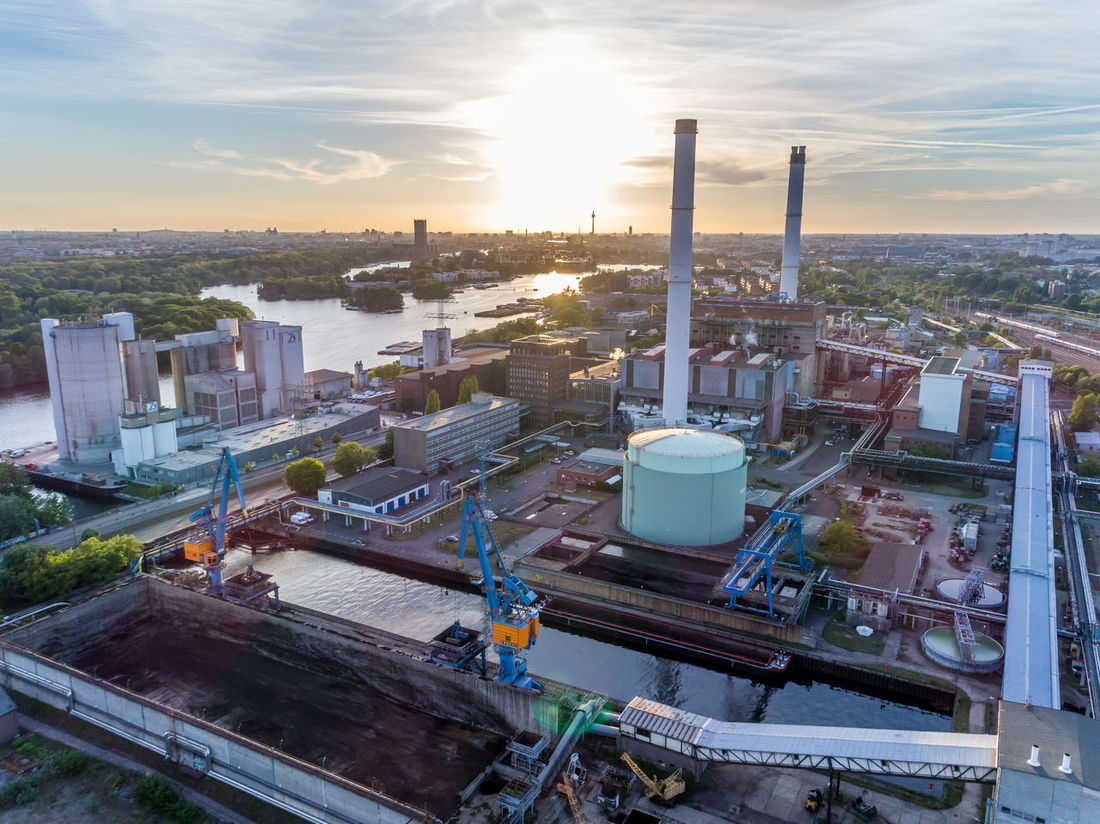 Aerial View Architecture Building Exterior Built Structure Chimney City Cityscape Day Factory High Angle View Industrial Industrial Inspection Industry Industry Inspection No People Outdoors Petrochemical Plant Sky Smoke Stack Storage Tank Sunset