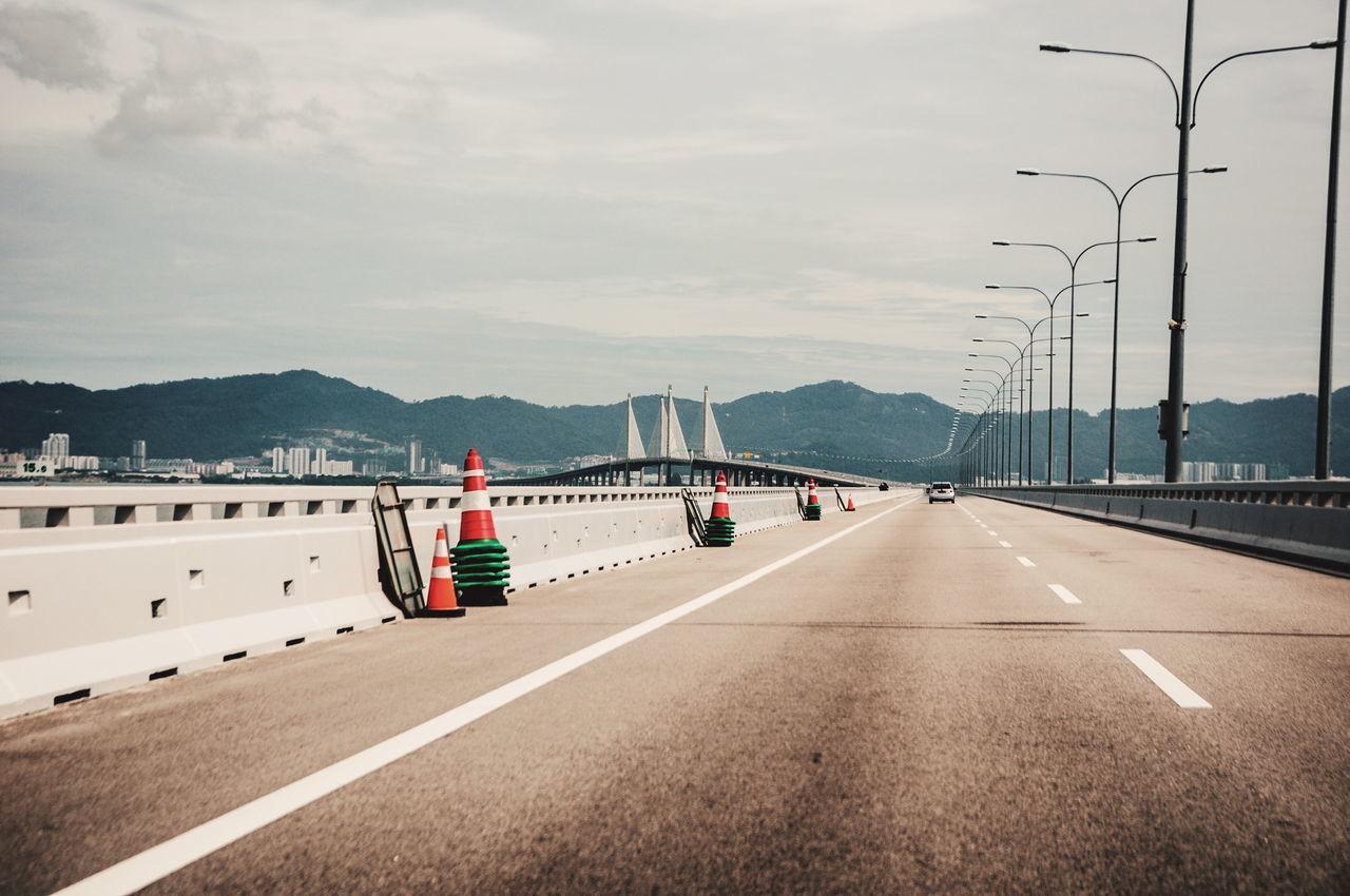 No Pepole Cloud Sky Car Metal Clouds And Sky Structure Pole Light Lamp Mountain Bridge Pulau Pinang Malaysia ASIA Penang Bridge Divider Road Highway Speed Landscape The Great Outdoors - 2016 EyeEm AwardsCone The Street Photographer - 2016 EyeEm Awards The Architect - 2016 EyeEm Awards