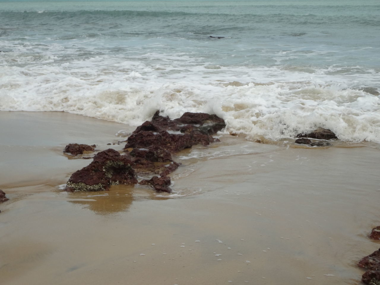 sea, water, nature, wave, beauty in nature, no people, rock - object, beach, outdoors, day, sand, scenics