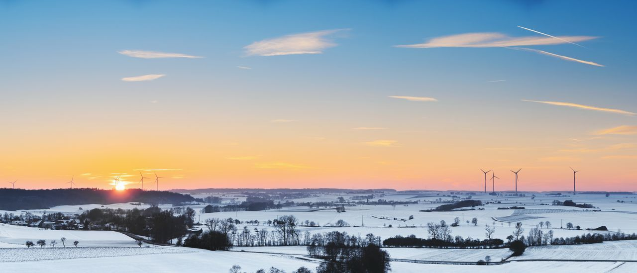 snow, winter, cold temperature, sunset, sun, sky, nature, scenics, weather, beauty in nature, tranquil scene, outdoors, sunlight, tranquility, landscape, cloud - sky, transportation, mountain, field, no people, mountain range, building exterior, architecture, tree, day