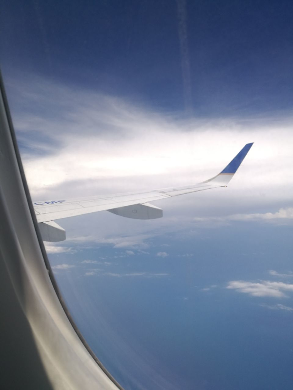 airplane, transportation, airplane wing, aerial view, sky, journey, air vehicle, cloud - sky, nature, mode of transport, no people, travel, flying, scenics, day, beauty in nature, mid-air, aircraft wing, blue, tranquility, outdoors, sea, horizon over water, close-up