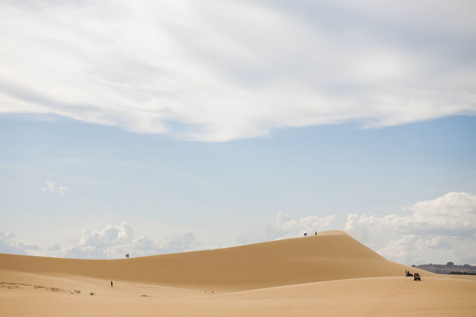 White Sand Dunes, Mui Ne, located in the south of Vietnam. It's about 5-hour away from Ho Chi Minh City. Adventure Arid Climate Beauty In Nature Cloud - Sky Desert Muine, Vietnam  Muito Outdoors Sand Sand Dune Travel Destinations Unrecognizable Person White Sand Dunes Break The Mold
