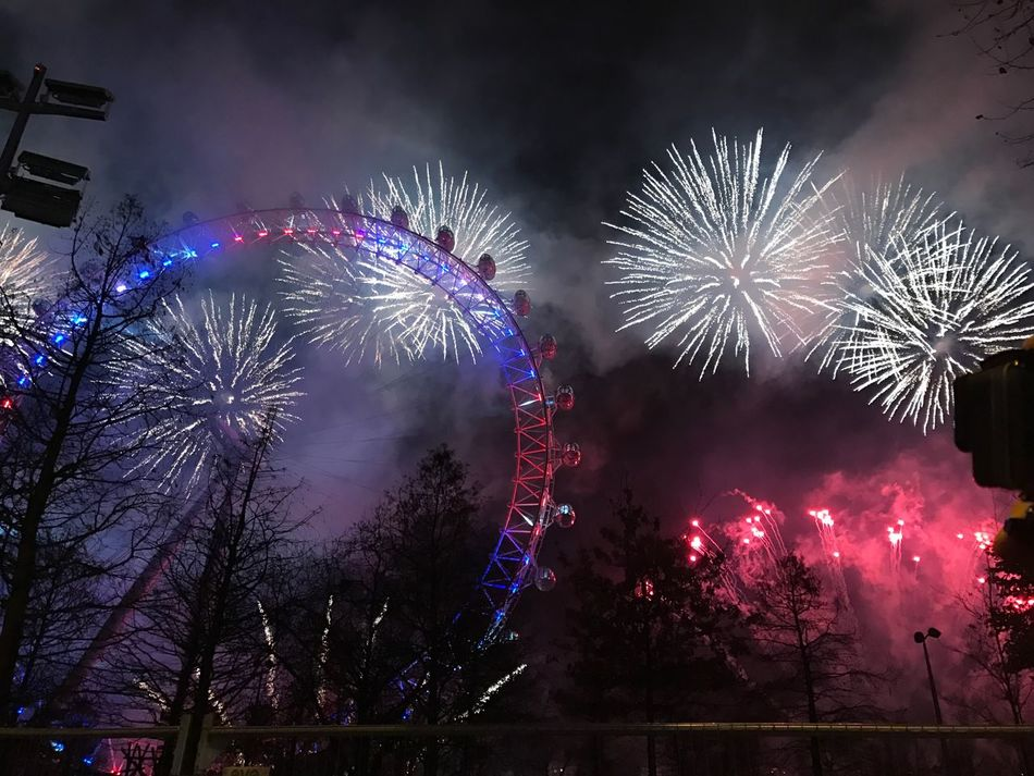 Firework Display Exploding Arts Culture And Entertainment Celebration London Eye London Nye2016 Sparks Event Night Glowing Celebration Event Illuminated Long Exposure Sky Firework Blurred Motion Low Angle View Smoke - Physical Structure Motion Outdoors Architecture