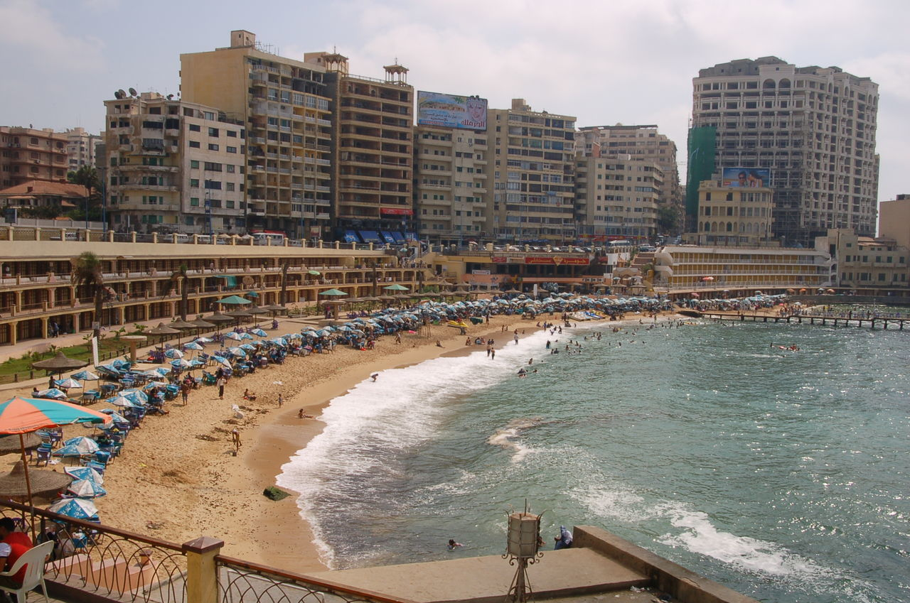 Alexandria Egypt Architecture Beauty In Nature Building Exterior Built Structure City Day Large Group Of People Nature Outdoors People Real People Stanley Beach Travel Destinations Water