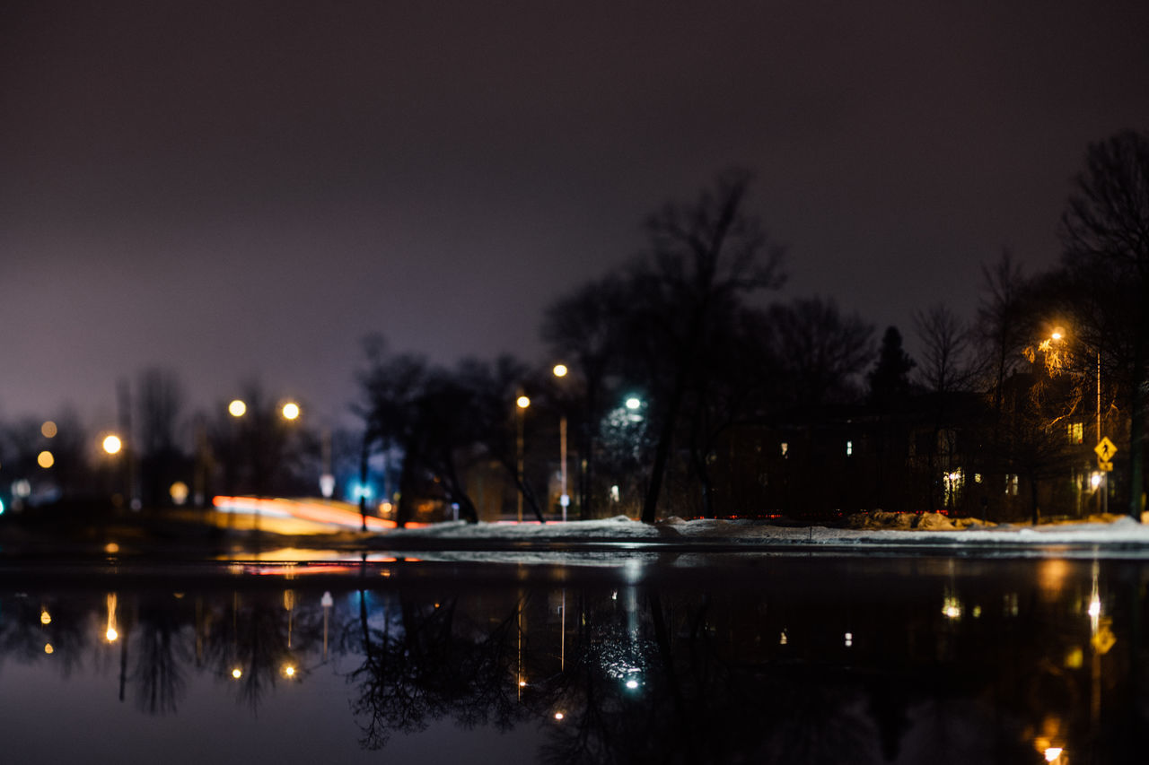 illuminated, night, tree, reflection, no people, sky, water, built structure, outdoors, building exterior, architecture, nature, city