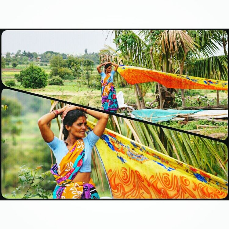 Women from the travel troop dry there saris in this way by tying one end to tree and holding the other end in hand standing in an open space where they can dry there cloths in wind Women Drying Clothes Saree Dailyritual Monsoonseason Color Of Life Snaping Pictures  Beauty In Nature People And Places