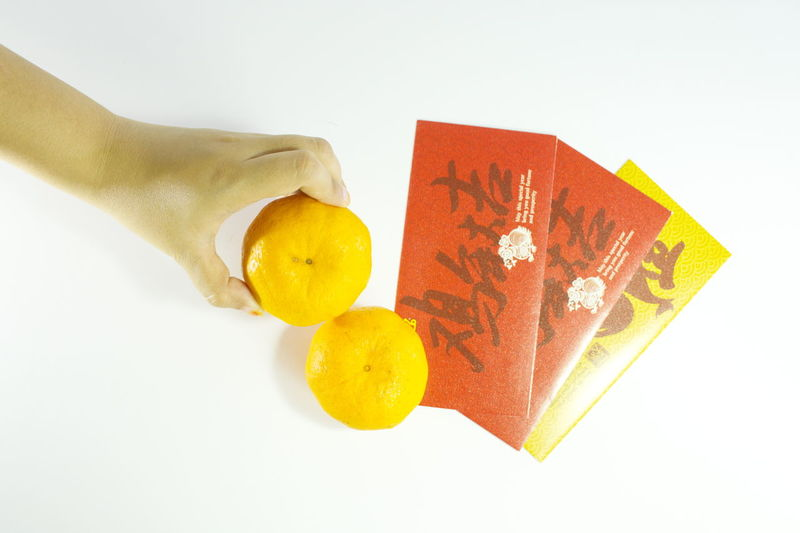 Yellow Studio Shot White Background Human Body Part Human Hand Relections Close-up Angpow Tradition Chinese New Year Culture Hands Give Angpow Ang Pao! Giving Money Ang Pao Indoors  Red Money Ang Pows Indoors  Indoors  Indoors  Chinese