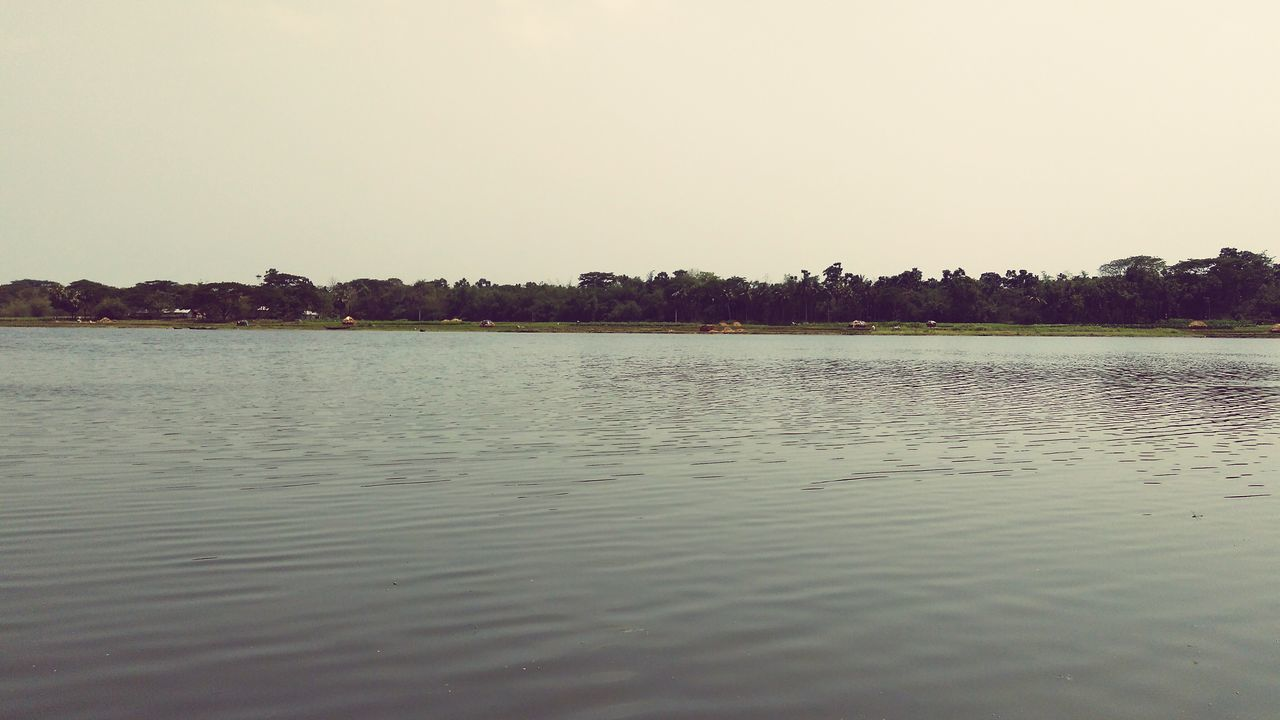 water, tranquil scene, tranquility, lake, no people, scenics, nature, waterfront, beauty in nature, outdoors, clear sky, sky, day, tree