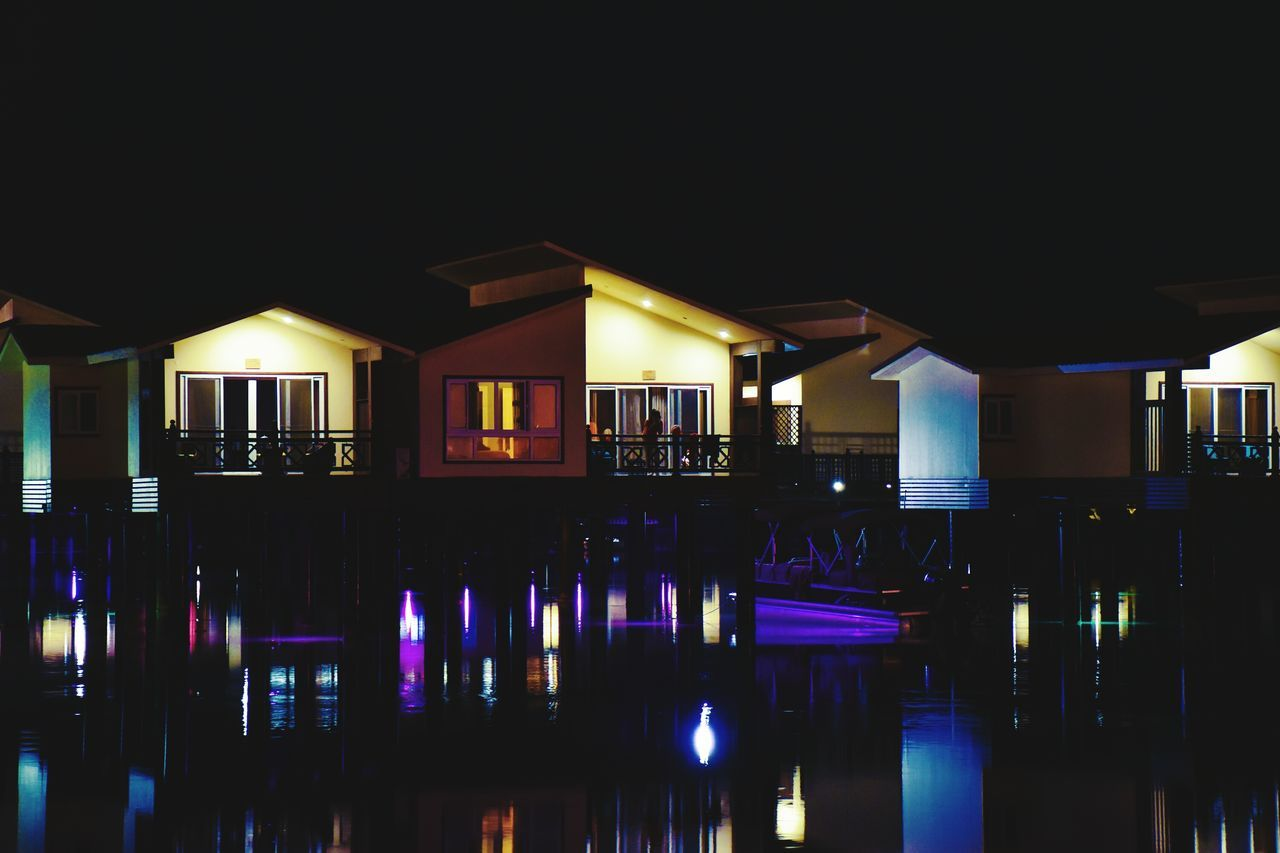 Living On The Water Floating Hotel Floating On Water On The Sea Water Reflection Illuminated Architecture No People Scenics Outdoors Floating Rooms Sea Building Exterior Darkness And Light Darkness Beauty Of The Night Colors Colorfull Sea At Night Rooms Dark Photography Night Lights Nightphotography Nighttime