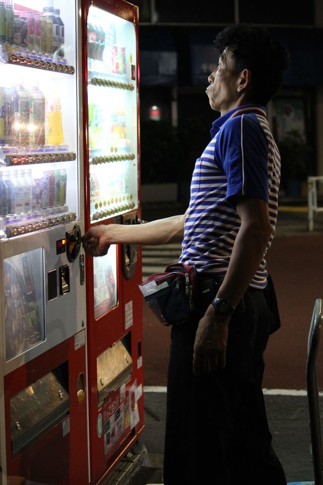 Man using one of the thousands of vending machines around Tokyo. Colour Of Life Full Length Light Light And Shadow Night Person Photojournalism Profile Streetphotography Young Adult