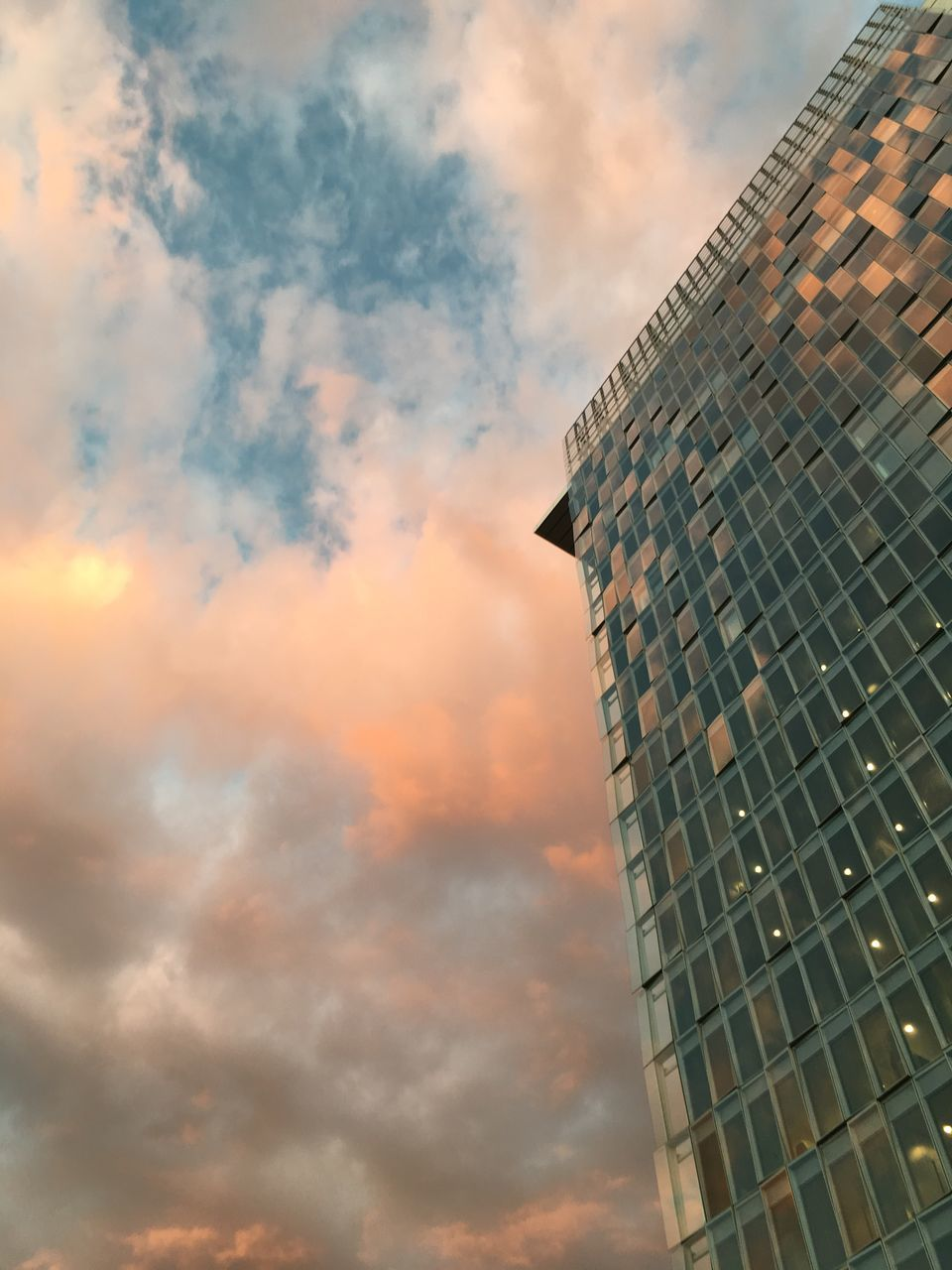 architecture, sky, building exterior, built structure, skyscraper, cloud - sky, modern, growth, no people, tower, low angle view, development, city, tall, sunset, corporate business, outdoors, day