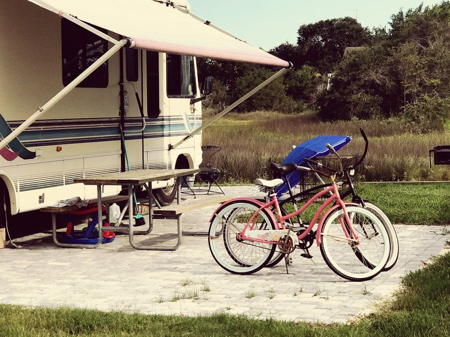 Hanging around and having fun at the campground. Where has everybody gone? Bike Bicycles Old Day No People Stationary Outdoors Tree Grass Nature Camper Campsite Recreational Vehicle Camping Kids Bikes Old Bikes Picnic Table Umbrella Grill 100 Days Of Summer