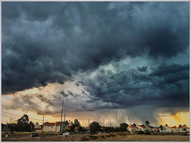 """""""Monsoon!"""" Neither as prompt or reliable as the South Asian Monsoon, the Western North America Monsoon shows up most years and usually sometime in June. With this year's extraordinary early heat (51°C!!), everyone has been wondering when and if the monsoon will materialize. The monsoon was extremely active in 2014 and 2015 with substantial rain in each summer month and a tropical storm in September 2014, the very early arrival of intense, record breaking heat that has persisted for the entire month of June had people wondering. The last few days humidity from the Pacific and the Sea of Cortez has been making its way slowly northeastward. Rain in s California and Arizona pushed into southern Nevada with heavy downpours, damaging hail, dangerous lightning and flash flooding in the southern and eastern portions of Las Vegas. Today was the first day since 3 June that the recorded high with ONLY be in the 90's Check This Out Relaxing Taking Photos Singing In The Rain No Heat  Relief Monsoon Monsoonseason WearherPro : The Perfect Weather Shot Thunderstorm This Week On Eyeem Showcase June EyeEmBestPics EyeEm Best Shots The Great Outdoors - 2016 EyeEm Awards EyeEm Gallery IPhoneography Malephotographerofthemonth From My Point Of View Eye4photography  Sky And Clouds Skyporn Sky"""
