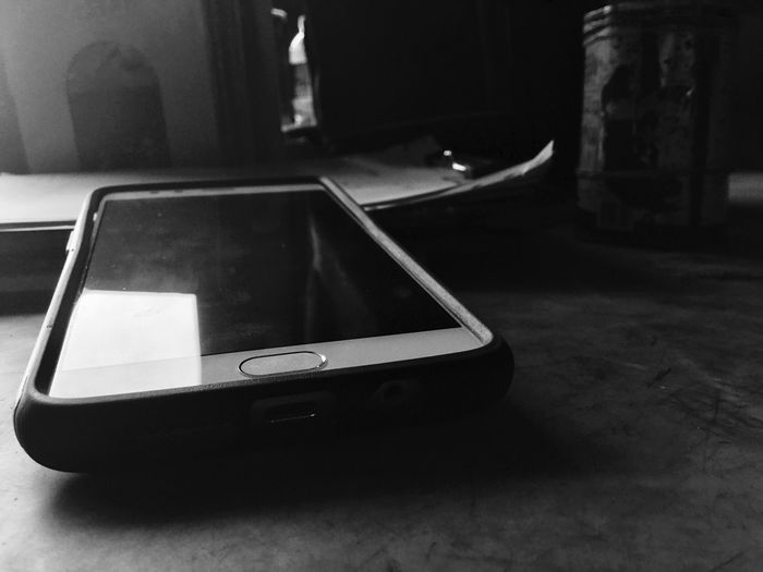 Wireless Technology Smart Phone Mobile Phone Portable Information Device Technology IPod Touch Photography Indoors  Close-up Connection Table No People Touch Screen Day Close Up Technology Blackandwhite IPod Touch DuaEnamKosongLima