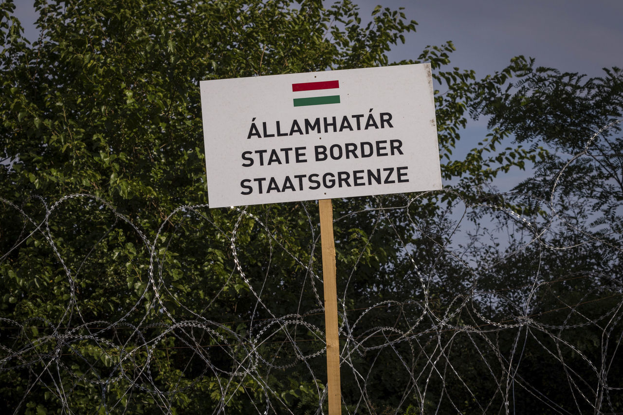 Firewall against illegal immigrants and refugees on the border between Hungary and Serbia Barbed Wire Barbed Wire Fence Border Borderline Communication Fence Firewall Frontier Frontière No People Outdoors State Border Text Warning Sign