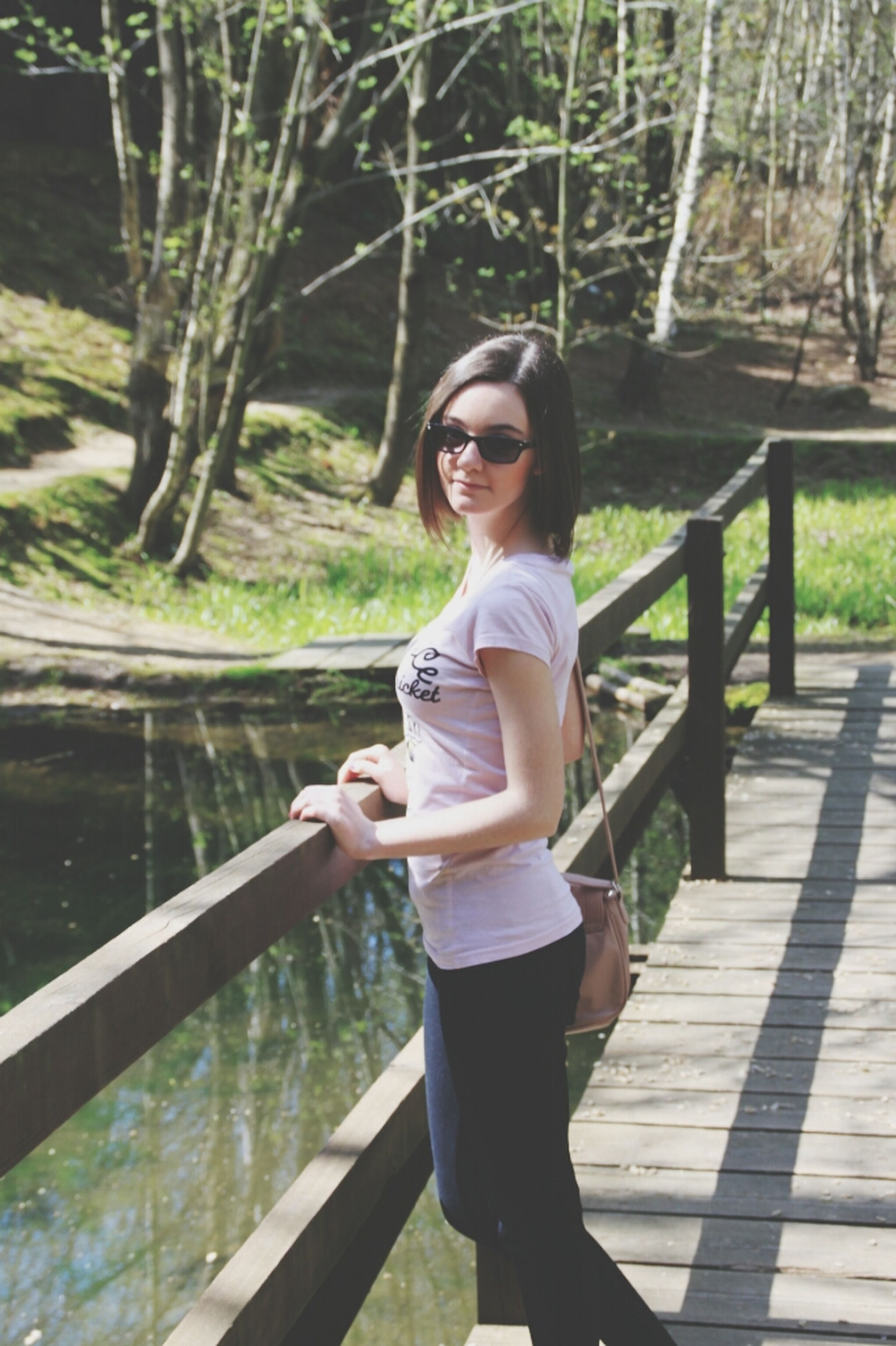 tree, young adult, lifestyles, person, casual clothing, leisure activity, water, full length, young women, standing, front view, looking at camera, portrait, lake, three quarter length, outdoors, railing