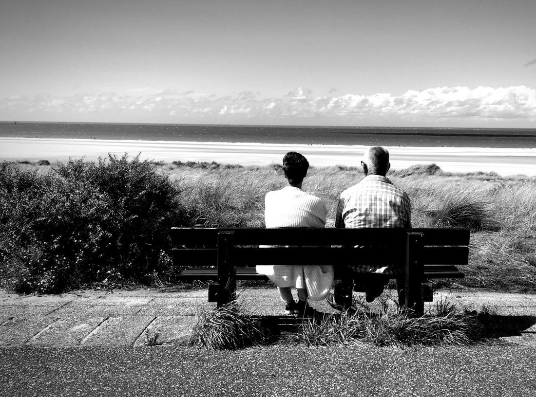 Sea Rear View Water Togetherness Nature Beach Two People Sitting Horizon Over Water Relaxation Sky Real People Outdoors