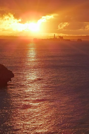 Sunset Offshore Anchorage Dramatic Sky Sea Water Sky Sunlight Sun Cityscape Nature Beauty In Nature Adapted To The City Outdoors Day