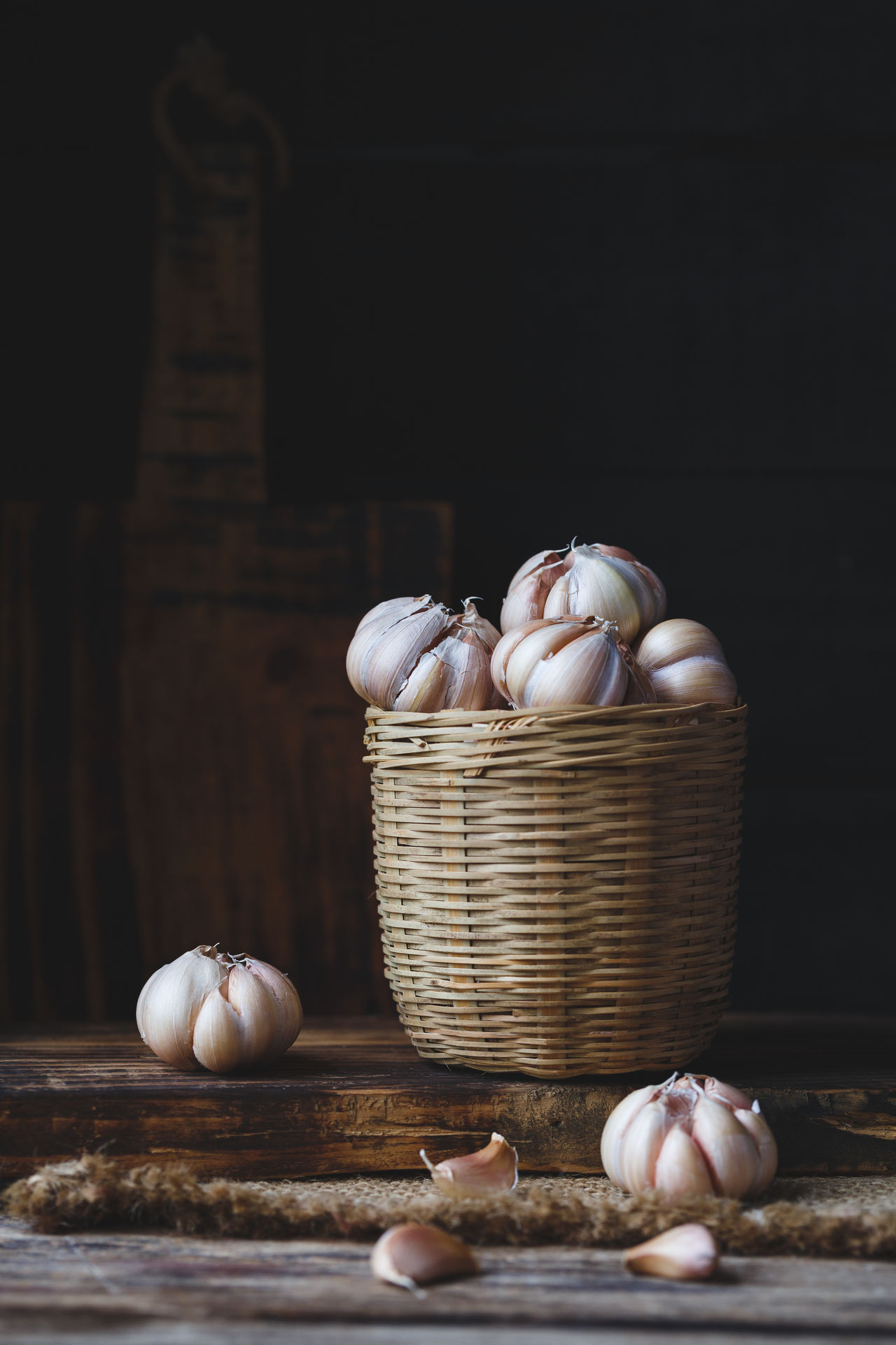 Garlic on the old wood Agriculture ASIA Bamboo Basket Burlap Dark Background Drug Dry Garlic Farm Food Garlic Healthy Food Isolated Medicine Natural Nutrition Old Wood Raw Rustic Spice Tasty Tropical Vietnam Whole