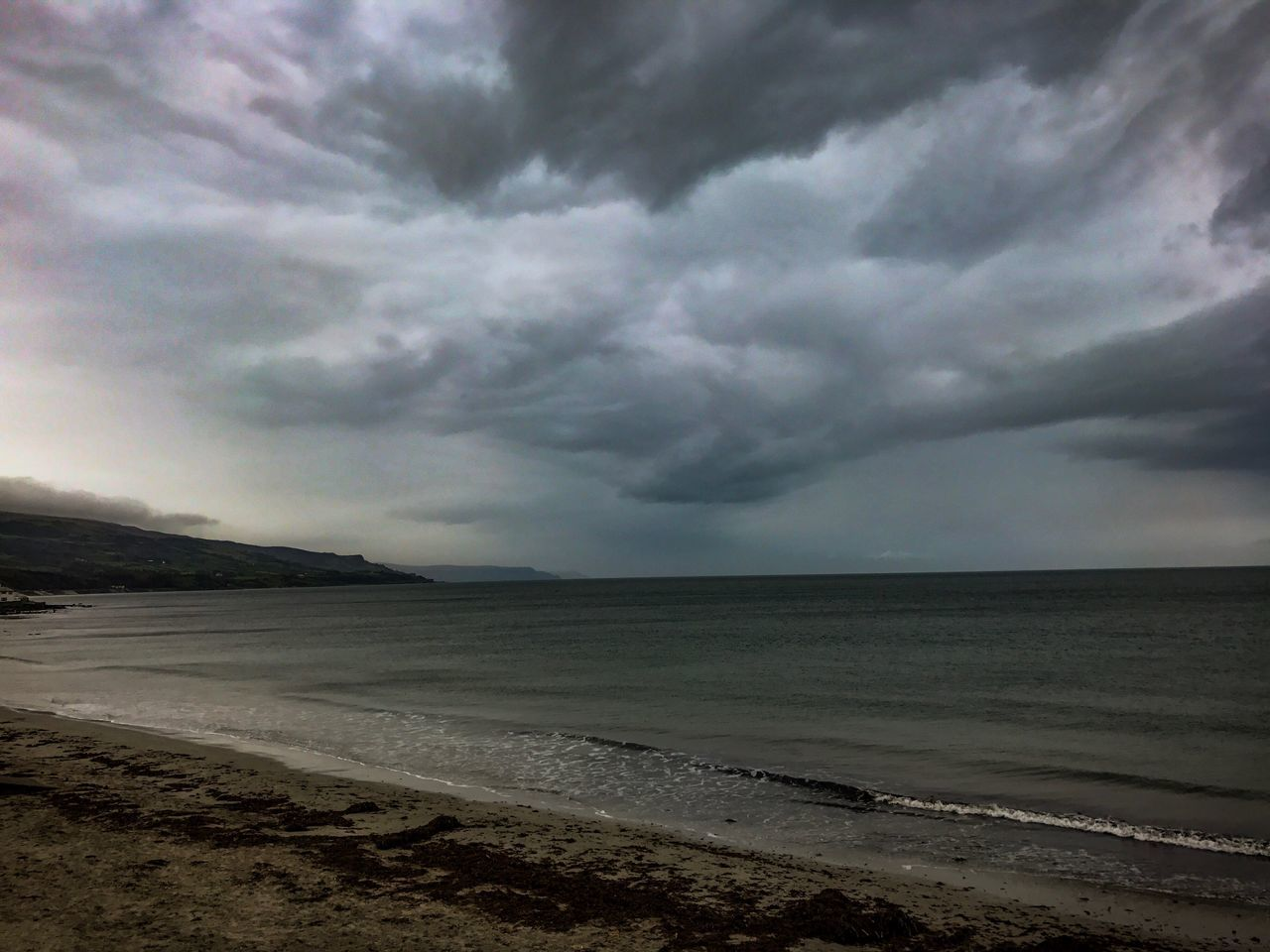 The rain is coming, Ballygally, County Antrim, Northern Ireland, North Coast, Cloud - Sky Sky Scenics Nature Sea Beach Tranquil Scene Beauty In Nature Tranquility Water Sand Horizon Over Water No People Outdoors Landscape Storm Cloud Day Travel Destinations EyeEmNewHere The Great Outdoors - 2017 EyeEm Awards