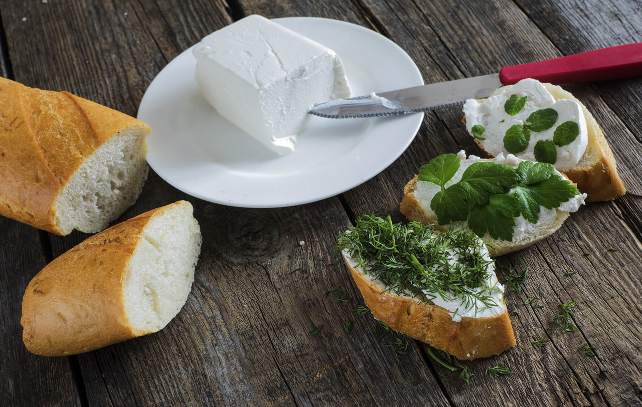 bruschetta with feta cheese and chopped spicy herbs on an old wooden weathered table Background Bread Bruschetta Cheese Chopped Close-up Feta Food Freshness Herbs Indoors  No People Old Planks Plate Spicy Table Weathered Wooden