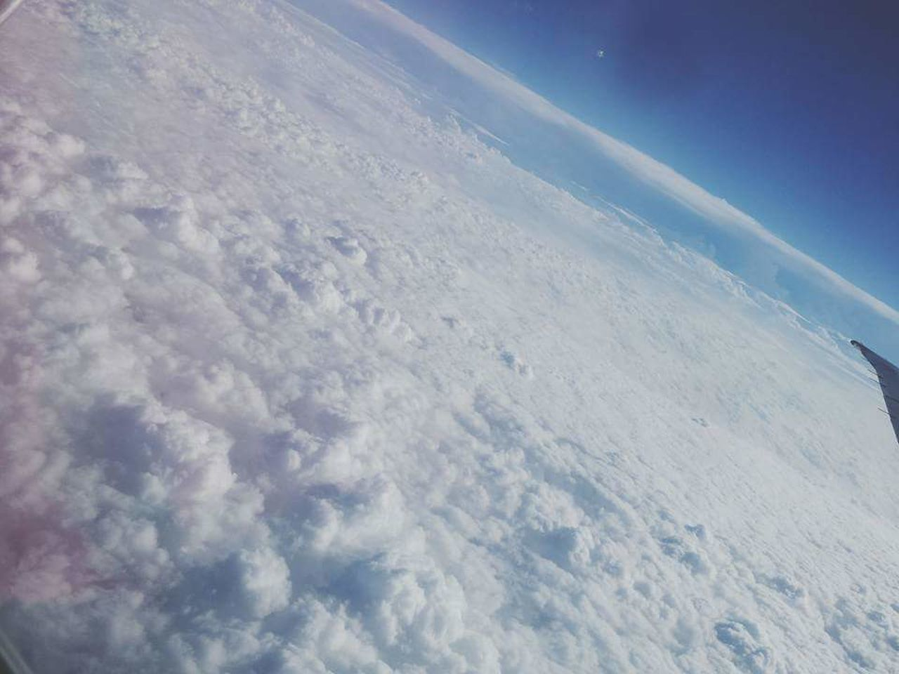 cloud - sky, sky, nature, aerial view, outdoors, day, scenics, space, no people, beauty in nature, winter, airplane, planet earth, satellite view, astronomy