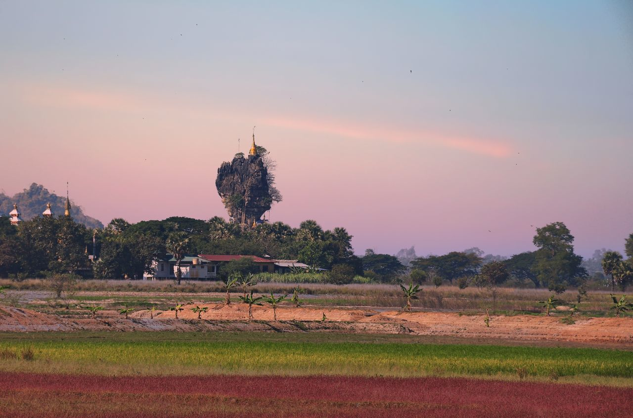 Kyauk Ka Latt Pagoda, located in Pa-an Township, Kayin State, Myanmar (as know as Burma) Beauty In Nature Grass Growth Kayin State, Burma. Landscape Myanmar Non-urban Scene Orange Color Outdoors Remote Rural Scene Sky Sunset Tranquility Travel Destinations Tree