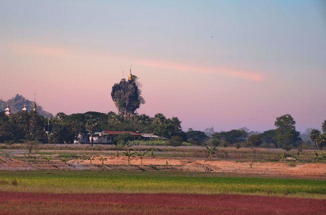 Kyauk Ka Latt Pagoda, located in Pa-an Township, Kayin State, Myanmar (as know as Burma) Beauty In Nature Grass Growth Kayin State, Burma. Landscape Myanmar Non-urban Scene Orange Color Outdoors Remote Rural Scene Sky Sunset Tranquility Travel Destinations Tree