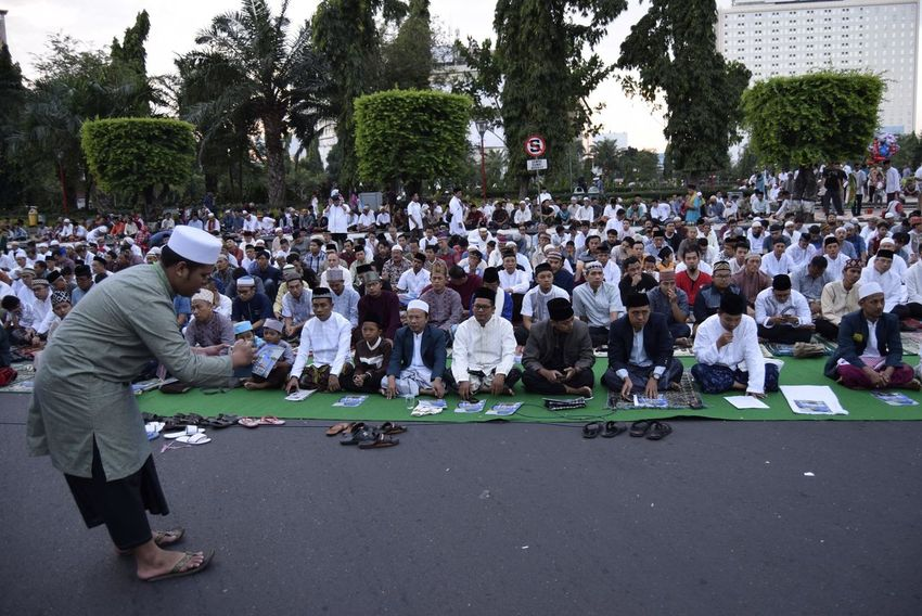 Thousands of worshipers attended Eid prayer at Pancasila Field, Simpanglima, Semarang City, Wednesday (June 25, 2017). The prayer prayer is led by KH Ulil Absror and khatib Ahmad Rofiq who is also a professor of Islamic Law as well as Director of Postgraduate of State Islamic University (UIN) Walisongo Semarang. Adult Adults Only Arts Culture And Entertainment Audience Central Java Crowd Day Full Length Ied Mubarak INDONESIA Large Group Of People Leisure Activity Men Moslem Outdoors People Performance Real People Semarang , Indonesia Sitting Togetherness Tree