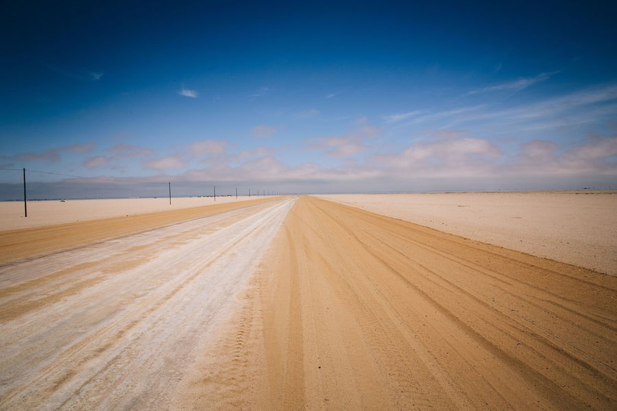 Road Trip Thru Namibia Africa African Desert Diminishing Perspective Driving Dust Freedom Horizon Over Land Landscape Liberty Nature Non-urban Scene Open On The Way Remote Road Road Trip Roadtrip Sand The Way Forward Tourism Travel Travel Destinations Vanishing Point Wildlife
