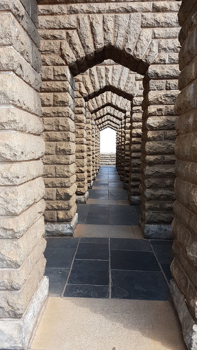 The Way Forward Built Structure Architecture Indoors  Arch Repetition Tunnel Steps Diminishing Perspective Day The Past History Castle Narrow Stone Material Archway Pedestrian Walkway Ancient Arched National Landmark From Where I Stand Pretoria Tshwane Voortrekker Monument