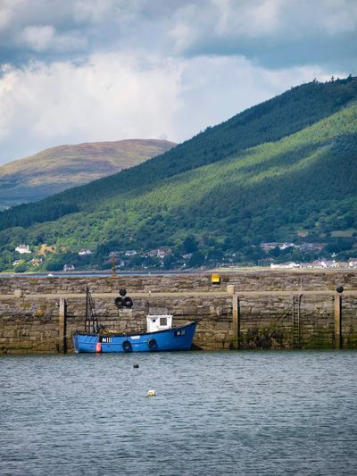Carlingford Lough Lough Mountain Transportation Water Sky Waterfront Cloud - Sky Mountain Range Tranquil Scene Mode Of Transport Scenics Tranquility Nature Beauty In Nature Non-urban Scene Cloudy Outdoors Day Majestic No People Boat Fishing Boat Summer Carlingford Ireland