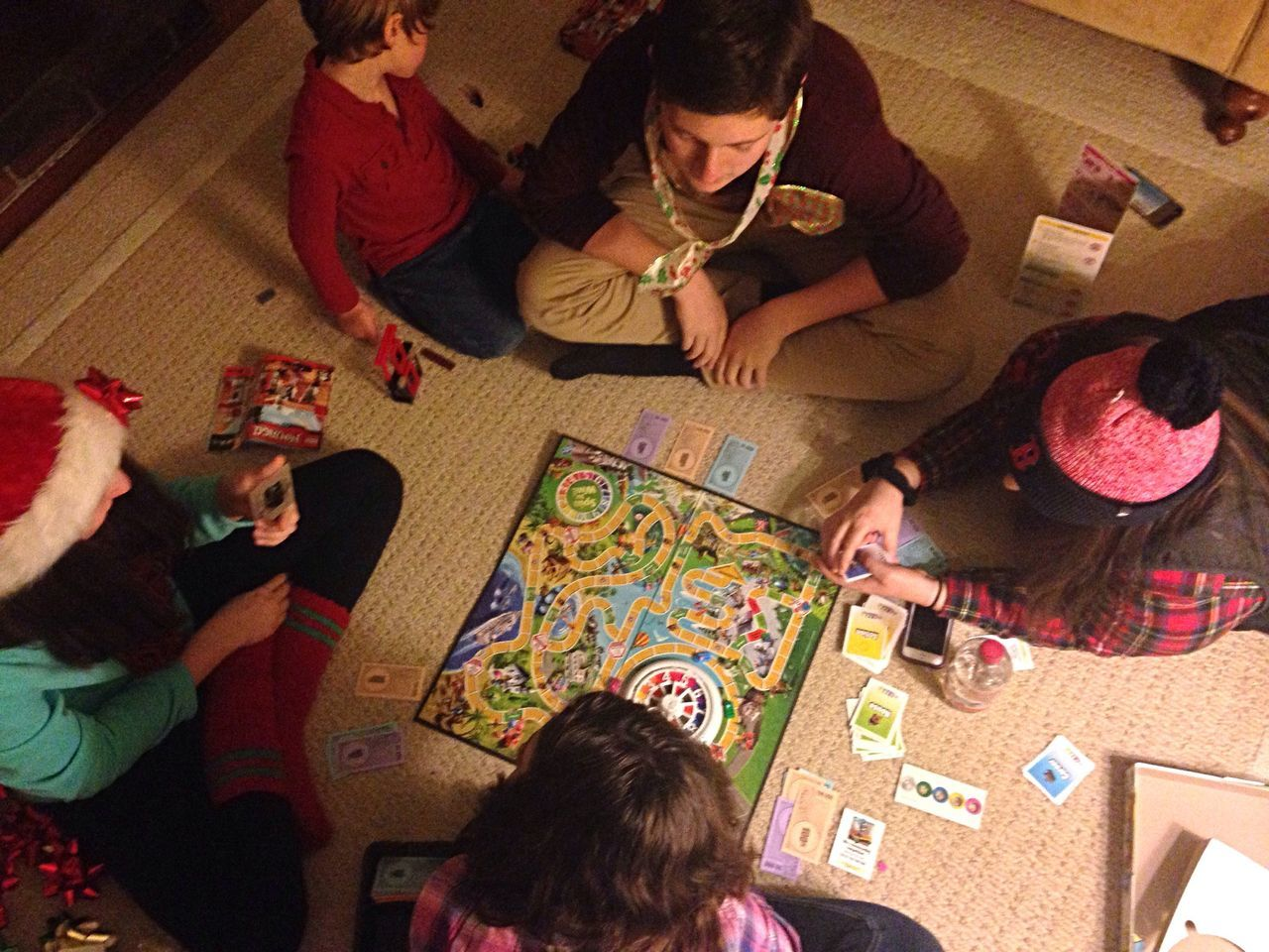 The Game of Life - the cousins going old school and playing aboard game after Xmas dinner Togetherness Playing High Angle View Living Room Cousins  Family Old School Boardgame View From Above Boys And Girls Leisure Games Snapping Pics Quiet Moments Family Time Hanging Out Having Fun Candid