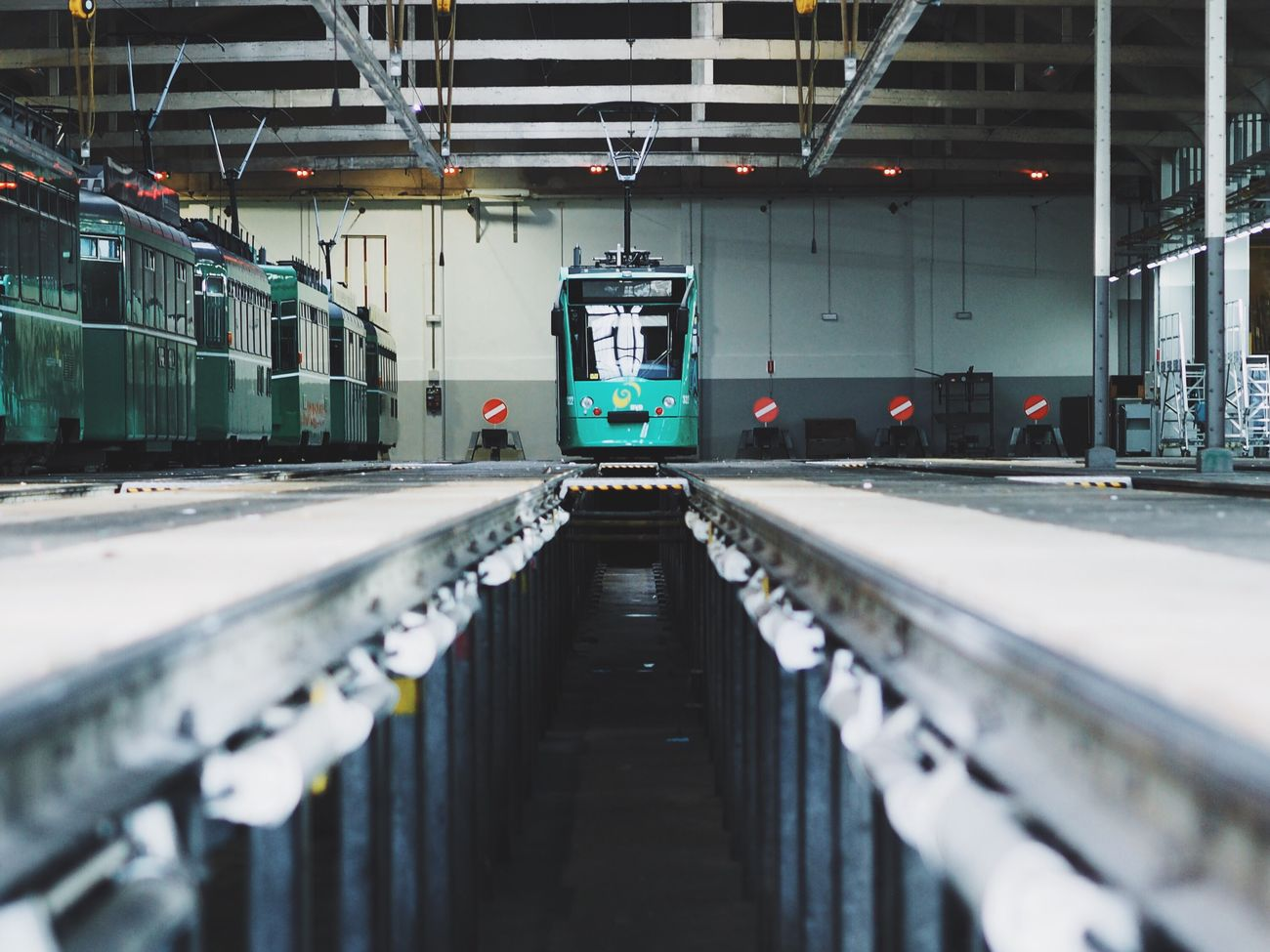 My Commute Public Transportation Tramdepot Tram Diminishing Perspective Symmetry Streetphotography No People Tram Depot Tram Stop City City Life at Basel, Switzerland Showcase June EyeEm X Mashable - My Commute