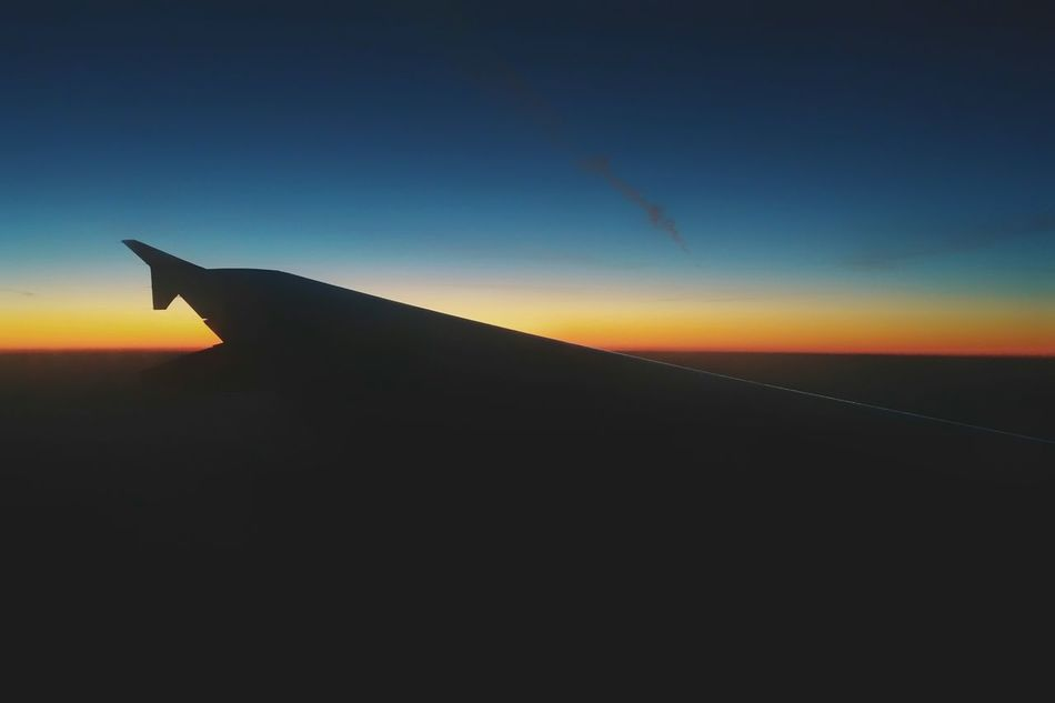 Sunset Flying Sky Silhouette No People Cloud - Sky Aerospace Industry Airplane Outdoors Day Travel By Night Travel Traveling Idyllic Sunlight Tranquility Colors Clear Sky Aerospace Nature Sunrise Above Above The Clouds Miles Away