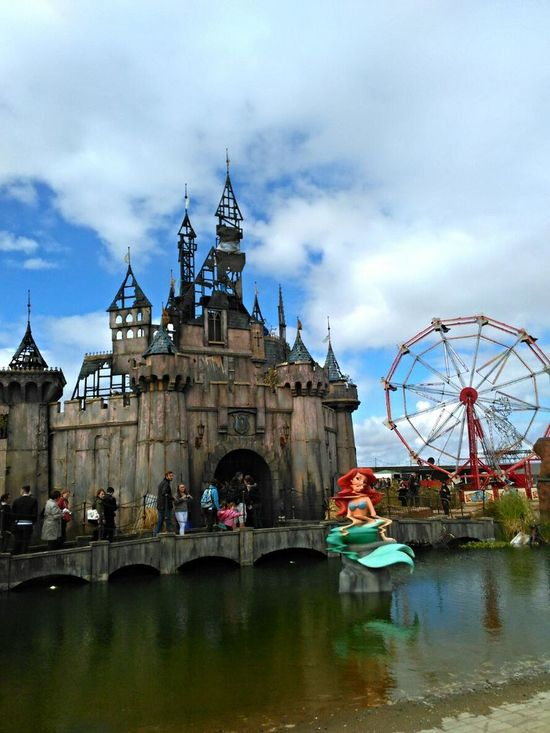 Water Dirty Water  Travel Destinations Travel Reflection River Cloud - Sky Ariel Wheel Ariel The Little Mermaid! Mermaid Arts Culture And Entertainment Leisure Activity England🇬🇧 Dismaland® Banksy Dismaland Banksyart United Kingdom Inglaterra Architecture Reino Unido Disney Disney Castle Castle