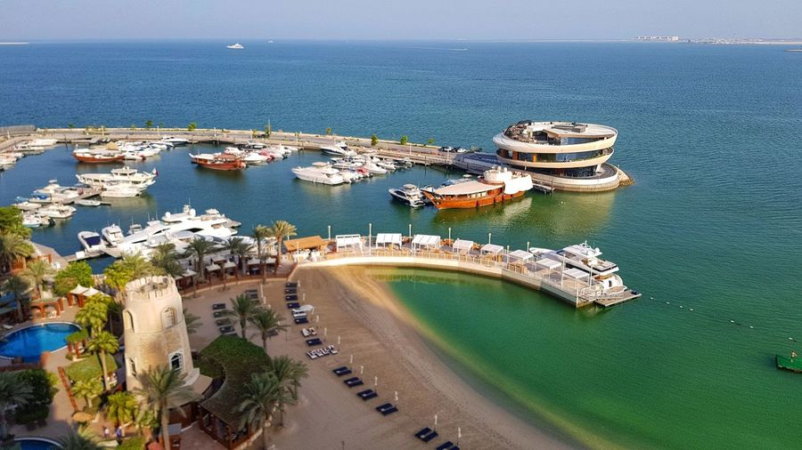 View Marina of Doha, Qatar Sea High Angle View Aerial View Water Nautical Vessel Beach Transportation Day Outdoors Architecture Travel Destinations Horizon Over Water Tree Sky The Week On EyeEm Been There. Done That. City Life Modern Restaurant Nobu Nobu Sushi Restaurant