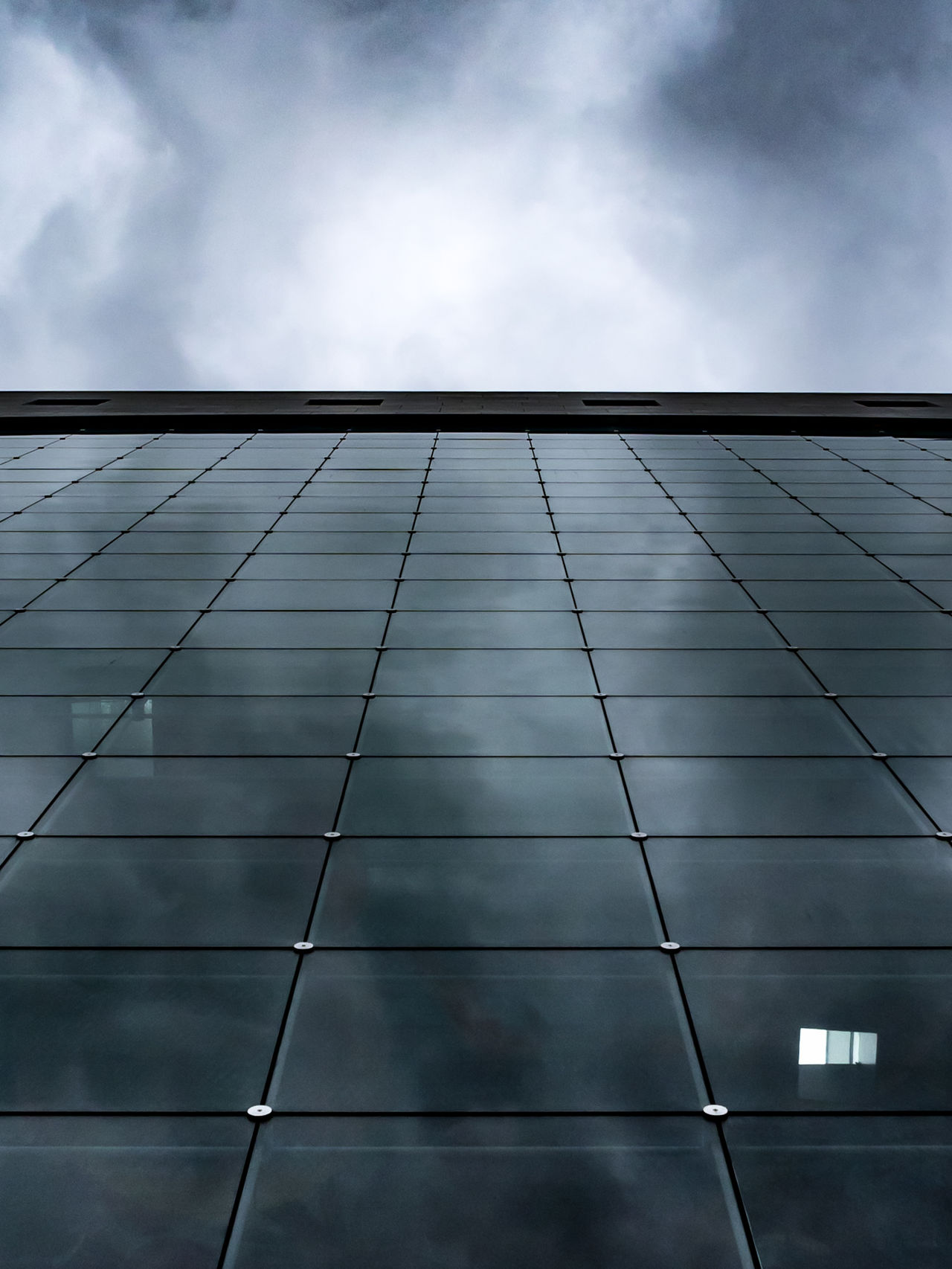 Looking up at glass and steel... Architecture Building Exterior Built Structure Business City Cloud - Sky Cold Copy Space Dark Day Low Angle View Markthal Modern Netherlands No People Outdoors Reflection Rotterdam Sky The Architect - 2017 EyeEm Awards Trade
