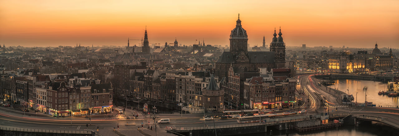 Amsterdam high angle panorama cityscape, taken just after sunset. View from the skylounge bar. Aerial View Amterdam Architecture City Cityscape Full Frma Historical Building Long Exposure Nederland Netherlands Outdoors Panorama View Tourist Destination Travel Travel Destinations Urban Skyline Urban Amsterdam Travel Destination Traffic Full Frame High Angle View Sunset Old City Mobility In Mega Cities