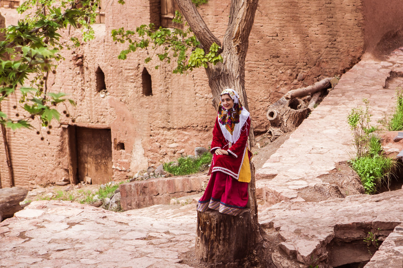 This is a girl in traditional dress and make pose for others. Abyaneh Architecture Clothes Cultures Dress Iran Iranian Iranian People Lifestyles Outdoors People Real People The Great Outdoors - 2017 EyeEm Awards The Photojournalist - 2017 EyeEm Awards The Portraitist - 2017 EyeEm Awards Traditional Clothing Traditional Costume Tree Women Young Adult Live For The Story Place Of Heart