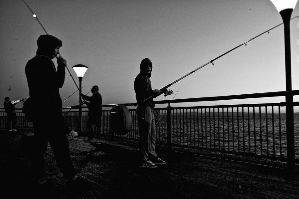 end of the pier Boscombe Boscombe Pier  Casual Clothing Dorset Fishing Fishing Boat Fishing Rod Full Length Hobbies Hobby Hoodie Leisure Activity Lifestyles Outdoors Pier Seashore Seaside Sky Sneakers Sunset Sunset Silhouettes Vape