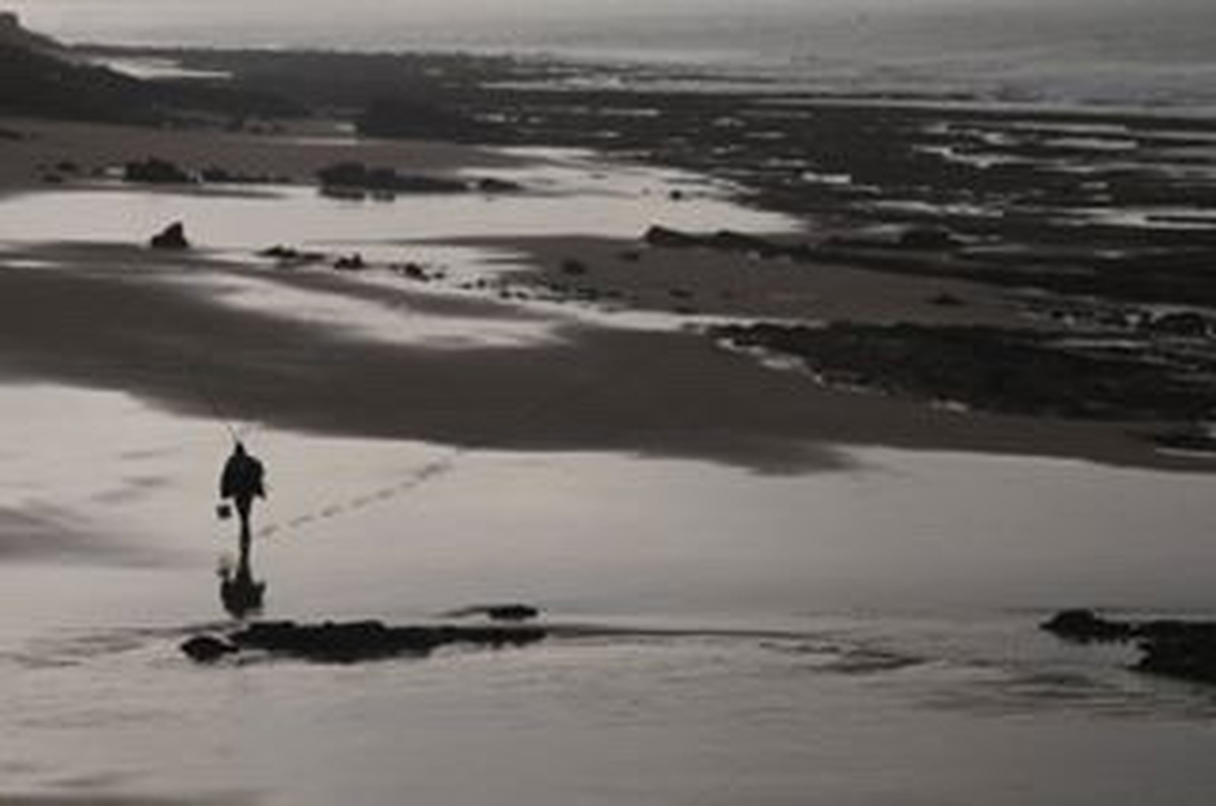 water, sea, beach, lifestyles, leisure activity, shore, tranquil scene, standing, scenics, men, tranquility, wave, full length, nature, walking, silhouette, beauty in nature, rear view